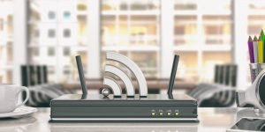 Wifi router in an office background. 3d illustration